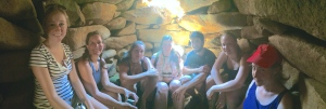 Participants relaxing in the tomb at the center of the megalithic structure.  (Pictured left to right: SC, EH, LT, GD, JB, RP, RH)