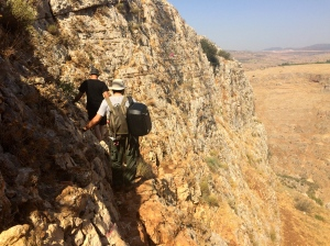 Walking along cliffs at Arbel.